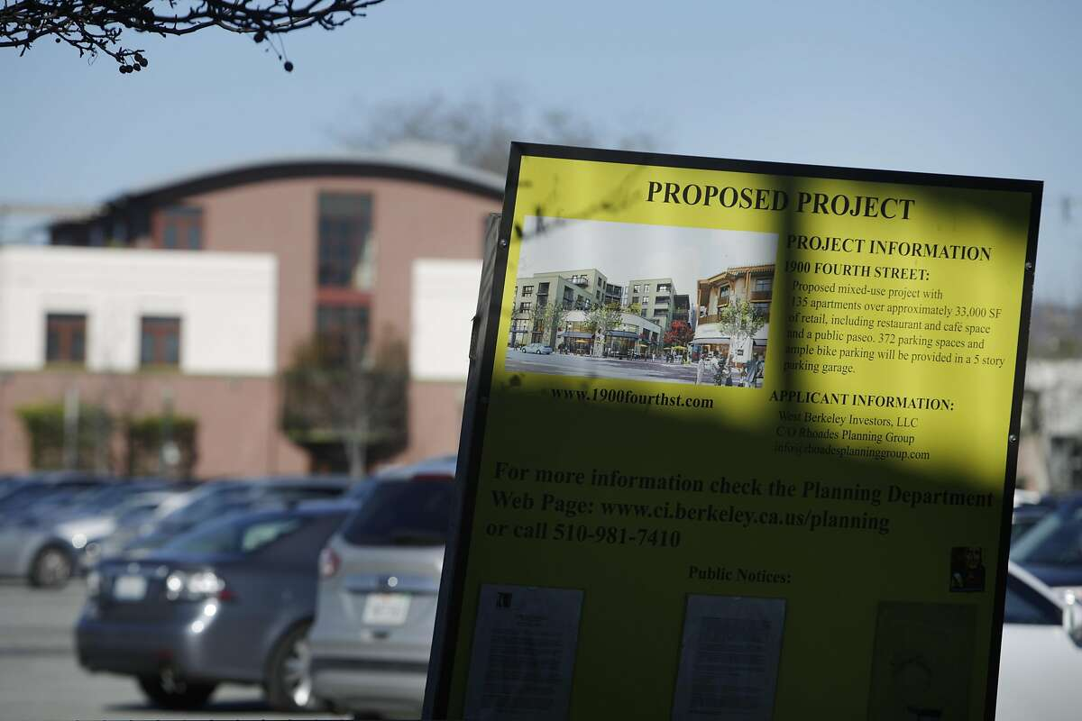 A sign for a proposed project is seen next to the Spenger's Fresh Fish Grotto parking lot, where a development is being proposed that would destroy 5,000 year old Native American burial remains currently beneath the parking lot on Friday, January 13, 2017 in Berkeley, Calif.