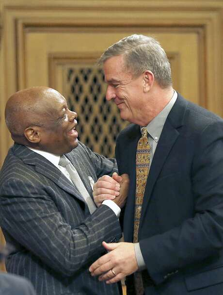 Former Assembly Speaker Willie Brown (left), a Chronicle columnist, congratulates new Supervisor Jeff Sheehy on his appointment. Photo: Liz Hafalia, The Chronicle