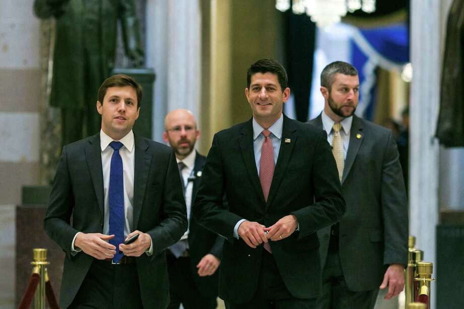 House Speaker Paul Ryan (R-Wis.) walks through Statuary Hall toward the House floor for a vote, at the Capitol building in Washington, Jan. 13, 2017. The House joined the Senate on Friday in moving speedily to repeal the Affordable Care Act, approving the Senate budget blueprint that would allow Republicans to act without the prospect of a filibuster. (Al Drago/The New York Times) Photo: AL DRAGO, STF / NYTNS