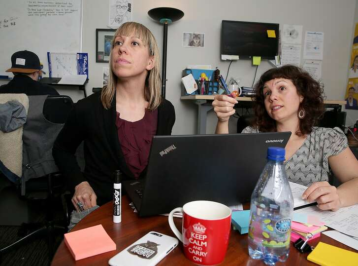 JVS director Sarah Jo Neubauer (left) of job search accelerator programs has a meeting with training coordinator Kristie Harris (right) on Friday, January 13, 2017 in San Francisco, Calif.