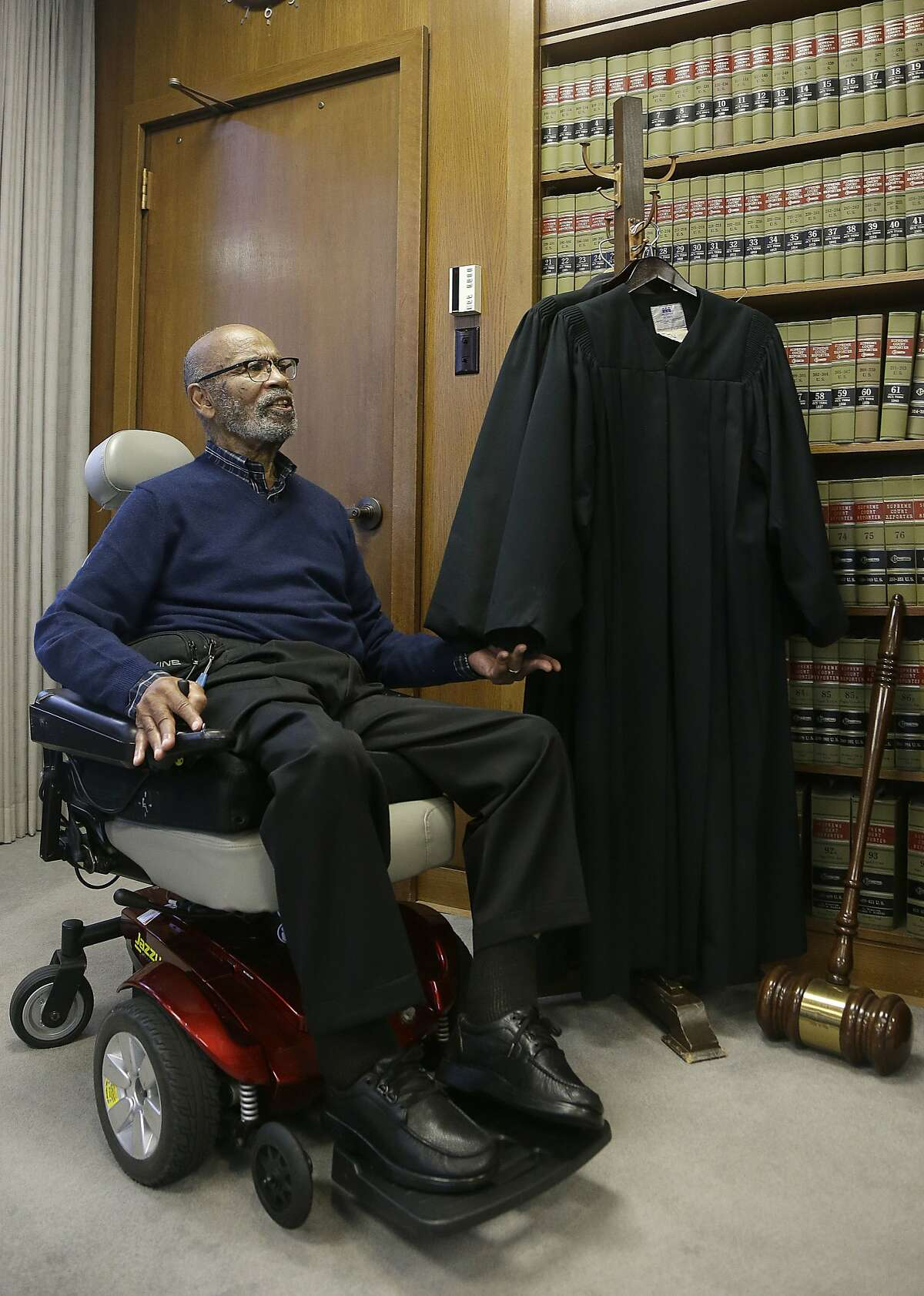 U.S. District Court Judge Thelton Henderson sits next to his robe while interviewed in his chambers in San Francisco, Tuesday, Jan. 10, 2017. Henderson, the first African-American attorney in the Justice Department's civil rights division, says he knows there will be more civil rights battles under the Trump administration, but at 83, he no longer has the energy to fight them. (AP Photo/Jeff Chiu)
