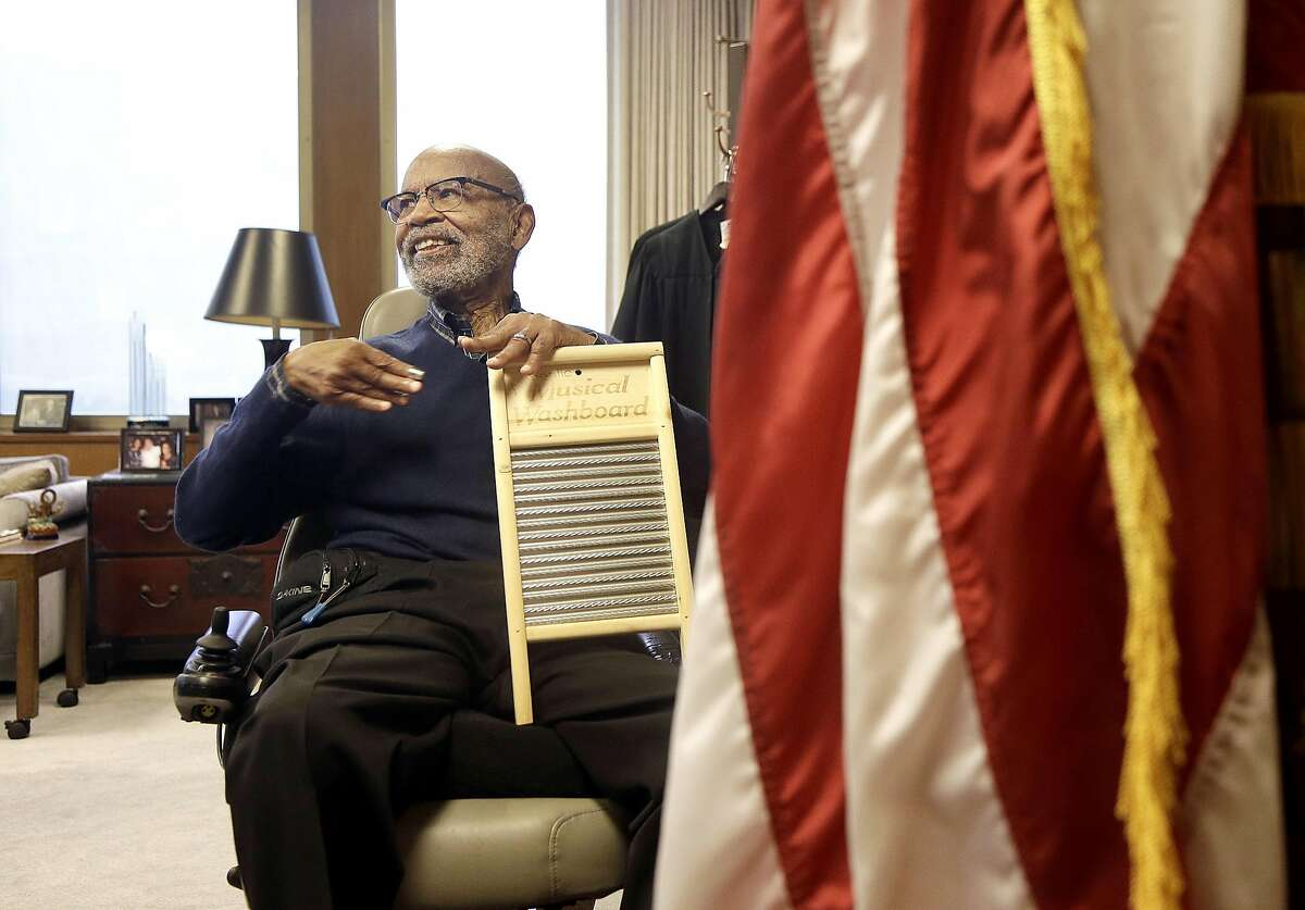 U.S. District Court Judge Thelton Henderson holds an instrument while interviewed in his chambers in San Francisco, Tuesday, Jan. 10, 2017. Henderson, the first African-American attorney in the Justice Department's civil rights division, says he knows there will be more civil rights battles under the Trump administration, but at 83, he no longer has the energy to fight them. (AP Photo/Jeff Chiu)
