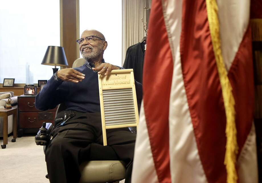 U.S. District Court Judge Thelton Henderson holds an instrument while interviewed in his chambers in San Francisco, Tuesday, Jan. 10, 2017. Henderson, the first African-American attorney in the Justice Department's civil rights division, says he knows there will be more civil rights battles under the Trump administration, but at 83, he no longer has the energy to fight them. (AP Photo/Jeff Chiu) Photo: Jeff Chiu, Associated Press
