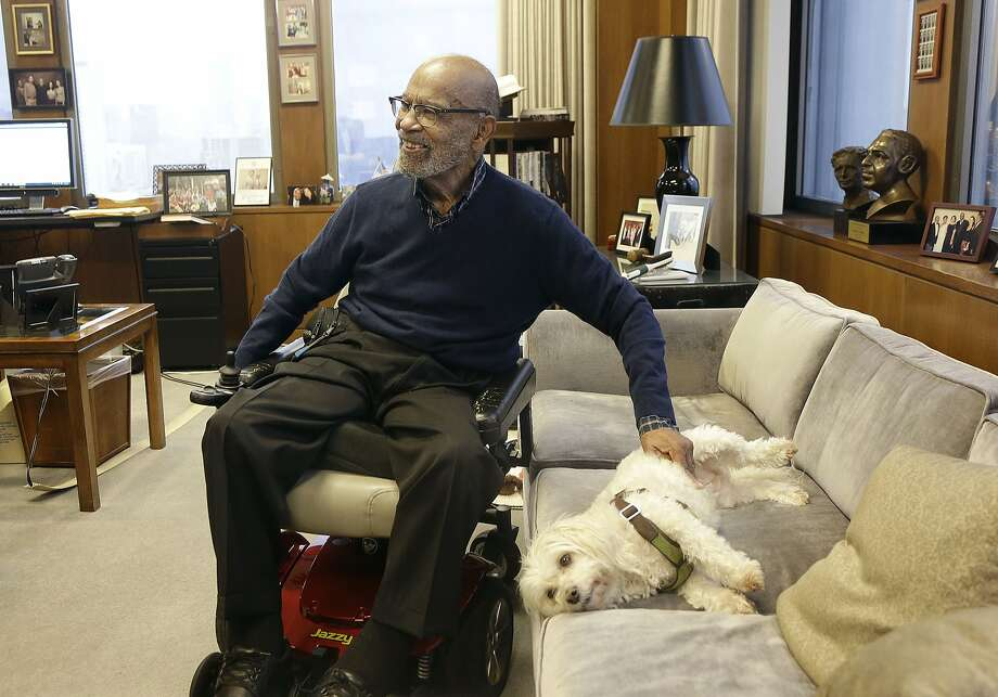 U.S. District Court Judge Thelton Henderson, a civil rights champion for more than 50 years, pets Missy in his chambers. Photo: Jeff Chiu, Associated Press
