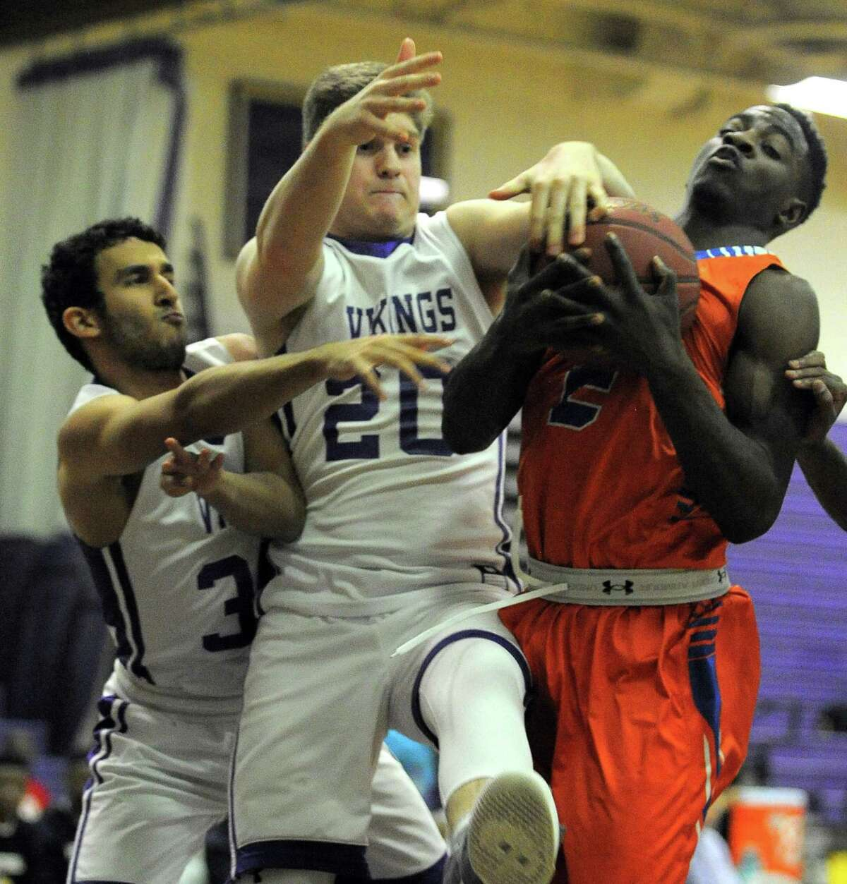 Westhill Jared Yaghoubian and Sam Lombino battle with Danbury Massiah Crandell for a rebound in a FCIAC boys basketball game at the Westhill High School's J. Walter Kennedy Athletic Complex in Stamford on Jan. 13, 2017.