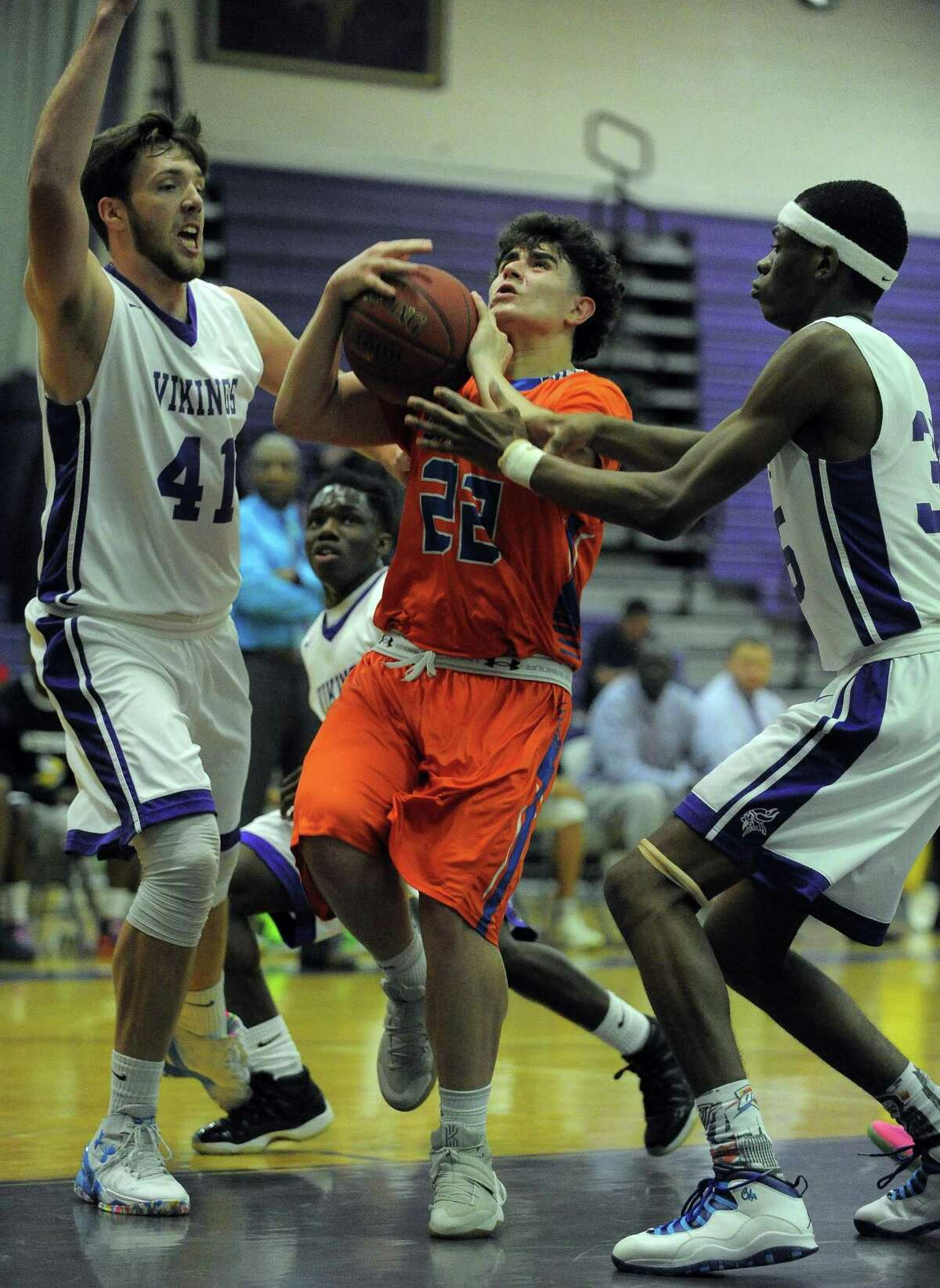 Danbury Cameron Snow drives between Westhill Hunter Semmel and J'ani Graham in a FCIAC boys basketball game at the Westhill High School's J. Walter Kennedy Athletic Complex in Stamford on Jan. 13, 2017.