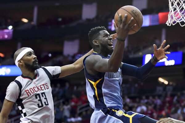 Memphis Grizzlies forward James Ennis, right, drives past Houston Rockets forward Corey Brewer (33) in the first half of an NBA basketball game, Friday, Jan. 13, 2017, in Houston. (AP Photo/Eric Christian Smith)