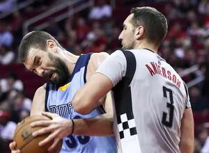Memphis Grizzlies center Marc Gasol, left, is fouled by Houston Rockets forward Ryan Anderson (3) in the first half of an NBA basketball game, Friday, Jan. 13, 2017, in Houston. (AP Photo/Eric Christian Smith)