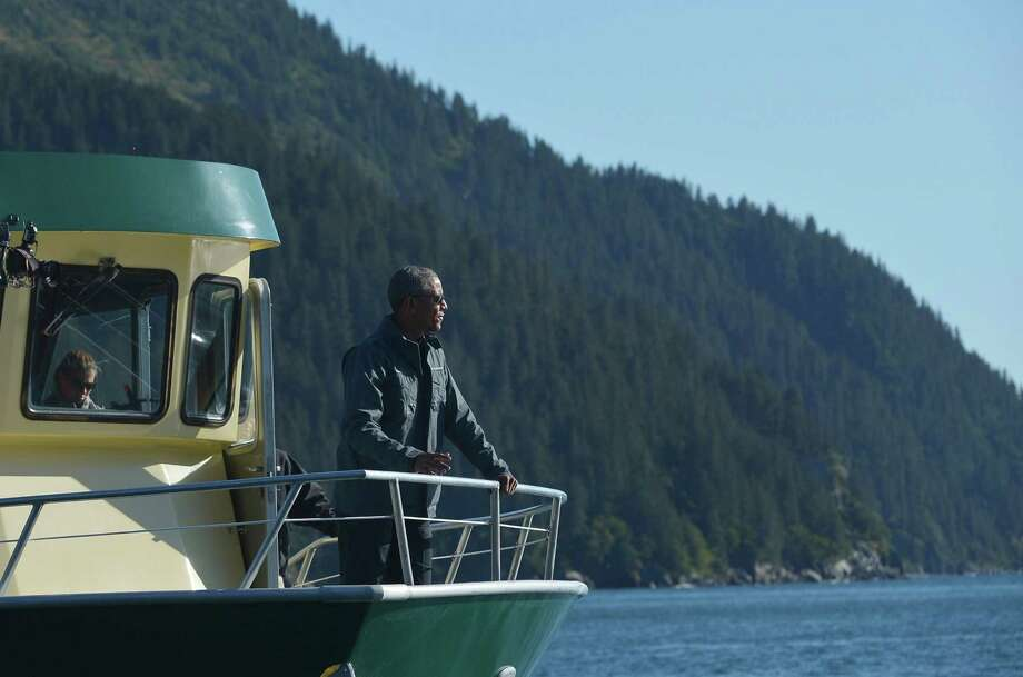 """PARKS AND MONUMENTS: US President Barack Obama stands on the bow of the """"Viewfinder"""" during a stop in Thumb Cove while touring Kenai Fjords National Park on September 1, 2015 in Seward, Alaska. AFP PHOTO/MANDEL NGAN (Photo credit should read MANDEL NGAN/AFP/Getty Images) Photo: MANDEL NGAN / AFP/Getty Images / This content is subject to copyright."""