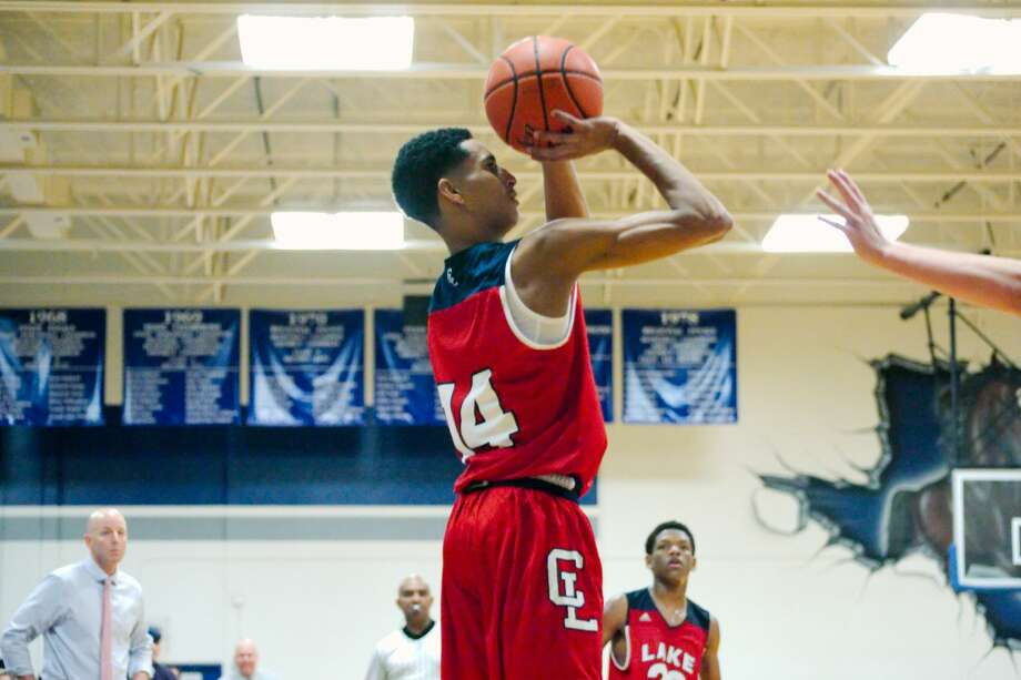 Clear Lake's Ajare Sanni (14) puts up a shot against Friendswood Friday, Jan. 13. Photo: Kirk Sides/Houston Chronicle