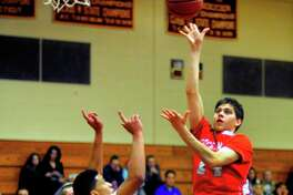 Greenwich's Robert Clarke tosses up a shot against St. Joseph in Trumbull on Friday night.