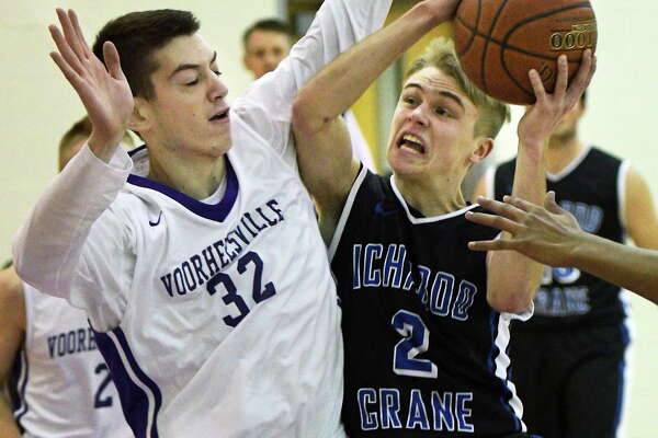 Voorheesville's #32 Adam Koniicki, left, and Ichabod Crane's #2Austin Valliere tangle during Friday's game  Jan. 13, 2017 in Voorheesville, NY.  (John Carl D'Annibale / Times Union)