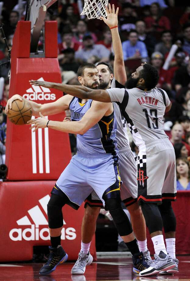 Houston Rockets guard James Harden (13) and forward Ryan Anderson apply defensive pressure to Memphis Grizzlies center Marc Gasol in the second half of an NBA basketball game, Friday, Jan. 13, 2017, in Houston. Memphis won the game, 110-105. (AP Photo/Eric Christian Smith) Photo: Eric Christian Smith/Associated Press