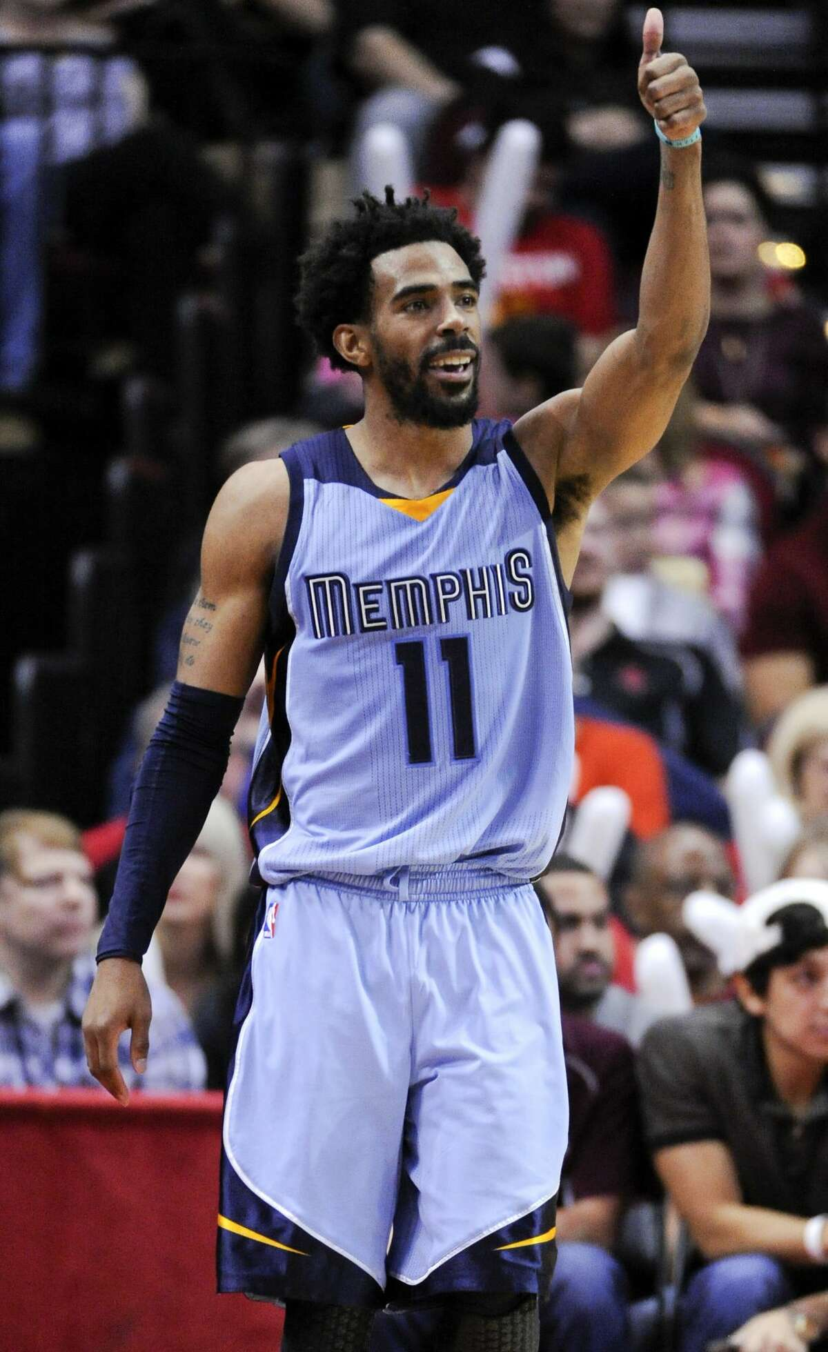 Memphis Grizzlies guard Mike Conley (11) reacts after making a 3-pointer in the second half of an NBA basketball game against the Houston Rockets, Friday, Jan. 13, 2017, in Houston. Memphis won the game, 110-105. (AP Photo/Eric Christian Smith)