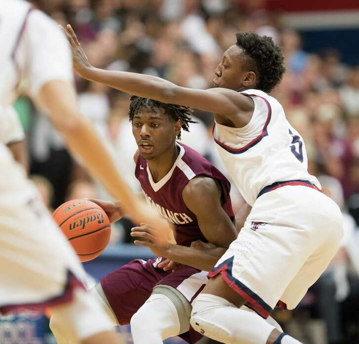 Cinco Ranch's Jay Jay Chandler, left, led all scorers with 31 points, but his Cougars couldn't keep pace with Tompkins in the 65-55 loss Friday night.