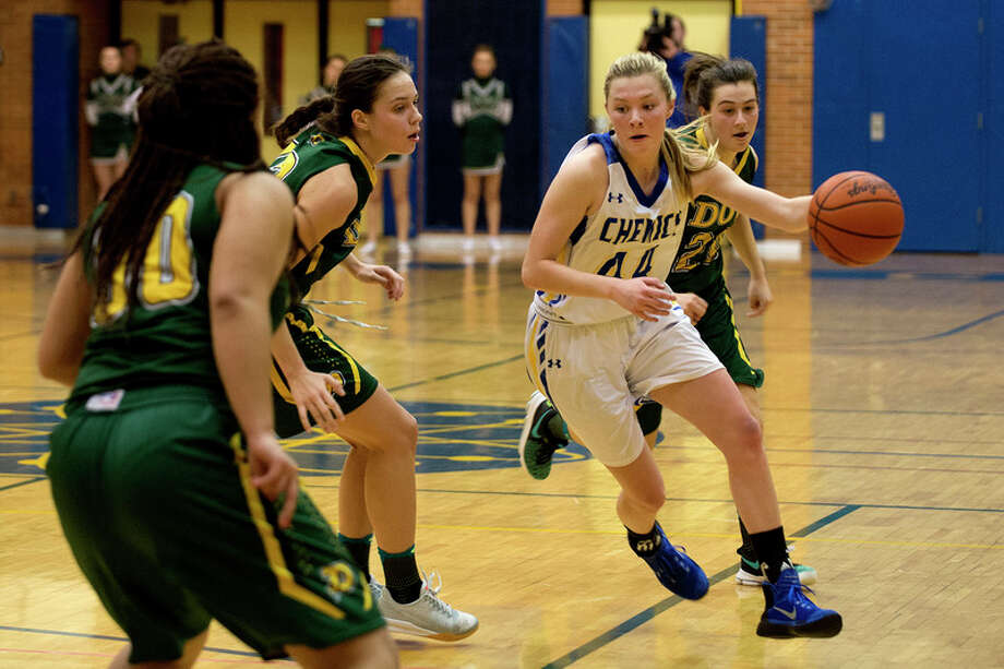 BRITTNEY LOHMILLER | blohmiller@mdn.net Midland High's Maddie Barrie dribbles around Dow High's Asjia Blanton, from left, Nadie Atton and Maizie Taylor in the second half of the Friday evening game at Midland High. Dow defeated Midland 52-51.
