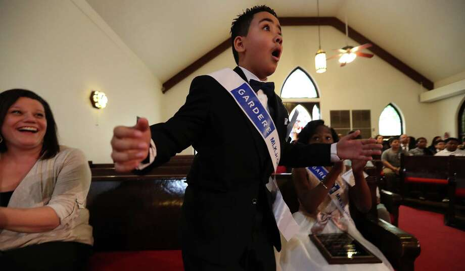 Crespo Elementary School fourth-grader Nhedrick Jabier is thrilled to learn he won first place and a $1,000 prize in the 21st annual Martin Luther King Jr. Oratory Competition Friday at the historic Antioch Missionary Baptist Church. Photo: Steve Gonzales, Staff / © 2017 Houston Chronicle