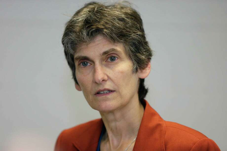 """Janet McCabe, acting assistant Environmental Protection Agency administrator for air quality, addresses the media at a dedication ceremony for a new heavy-duty truck testing lab, Tuesday, Oct. 13, 2015 in Ann Arbor, Mich. McCabe wouldn't say if Volkswagen's failure to disclose the defeat device software in its 2016 application for emissions certification was illegal. """"I don't want to speak to any potential subjects of an enforcement activity,"""" she said. (AP Photo/Carlos Osorio) Photo: Carlos Osorio, STF / AP"""