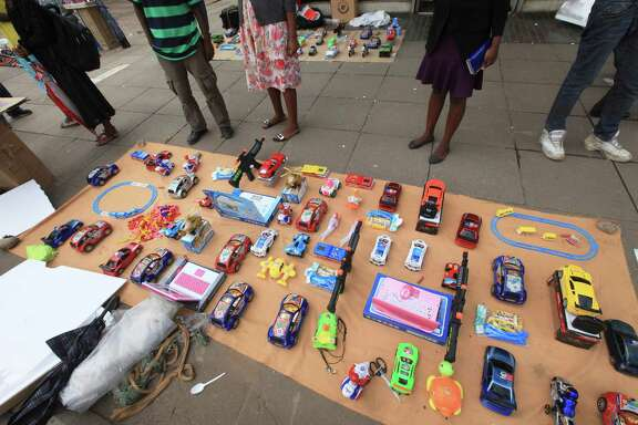 Consumers look over toys for sale before Christmas in Harare, Zimbabwe. A cash crunch is so severe that banks are capping customer withdrawals at $150 a week.