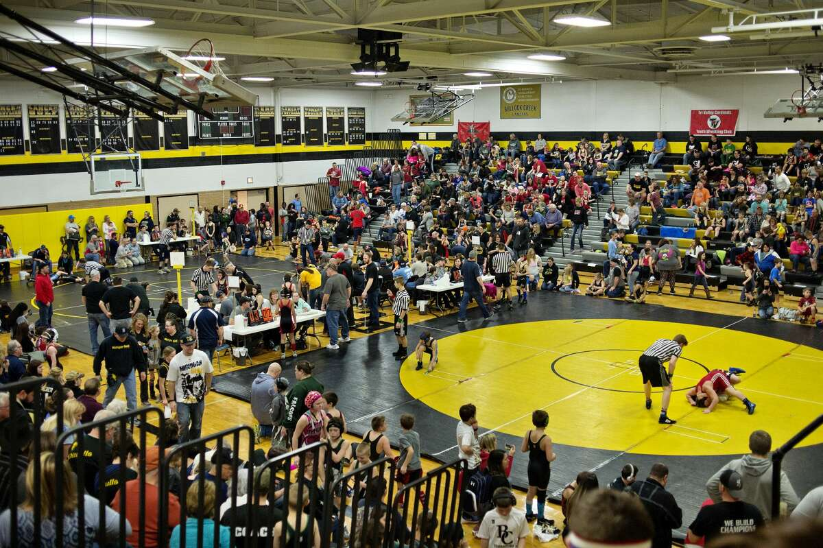 Wrestlers on different mats compete during a youth wrestling tournament on Saturday at Bullock Creek High School. Bullock Creek Youth Wrestling Club hosted the youth wrestling tournament where about 500 wrestlers participated.