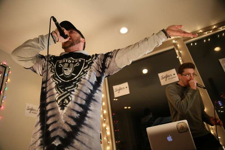 "From left: Troy Boyd (a.k.a. Obvi) and Stephan Roubinian (a.k.a. Catalyst Bars) of ""Alien Family"" rap during a Sofar Sounds concert on Friday, Jan. 13, 2017, in San Francisco, Calif. The concert was held at a house in the Twin Peaks neighborhood. The exact venue location is a secret, as is the talent scheduled to perform until the day of the concert."