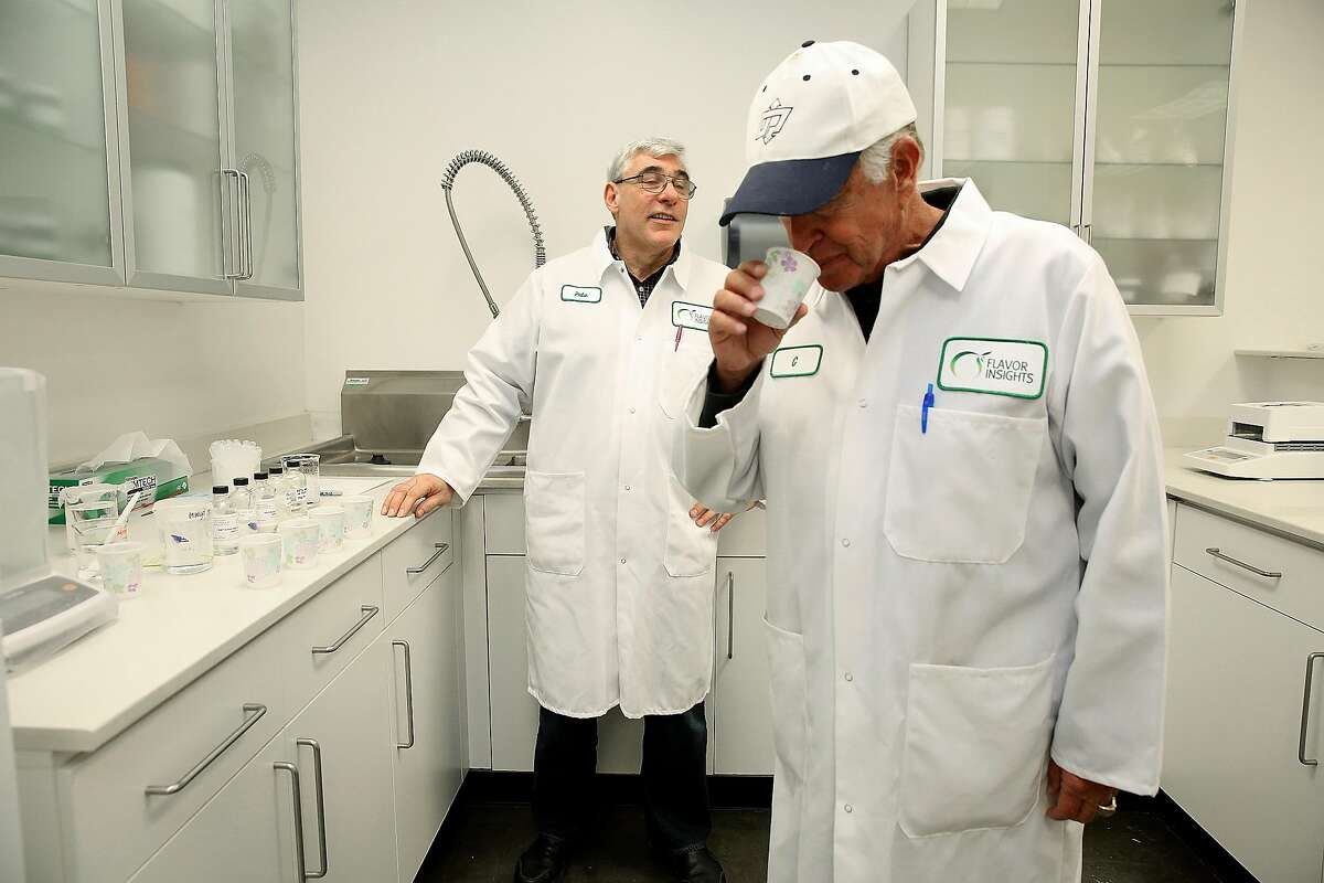 Greg Pickett (right) sniffs a green apple flavor in the R&D lab at Flavor Insights on Friday, January 13, 2014 in Benicia, Calif. At left is flavor chemist Pete Wasko.