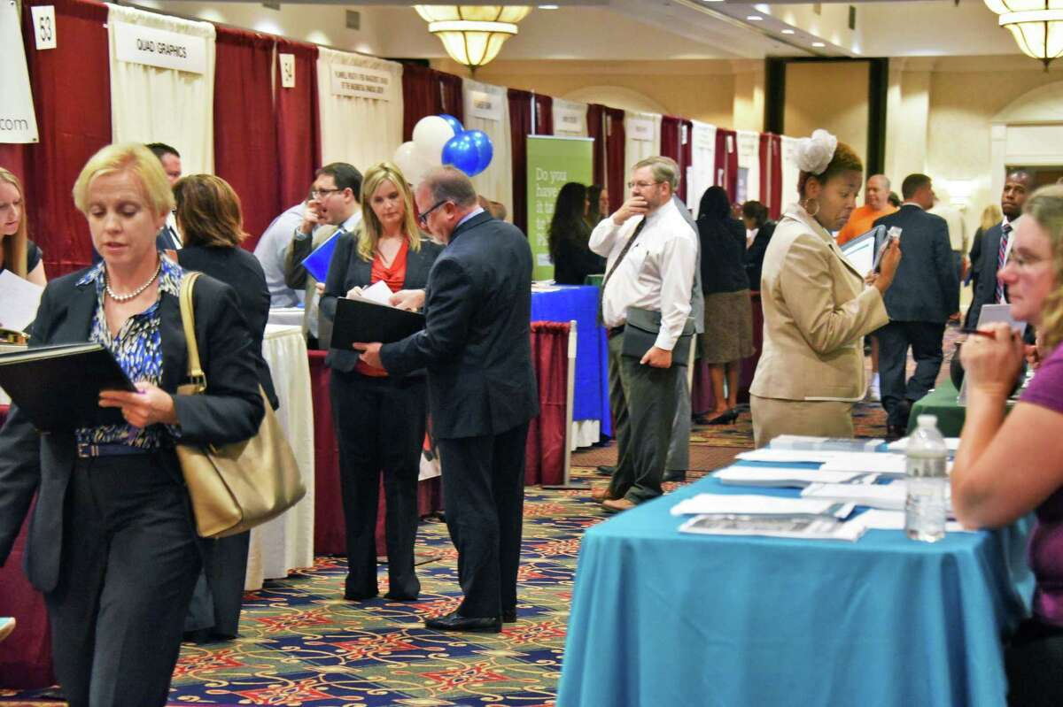 Job seekers tour the Times Union Job Fair at the Albany Marriott Wednesday Oct. 19, 2016 in Colonie, NY. (John Carl D'Annibale / Times Union)