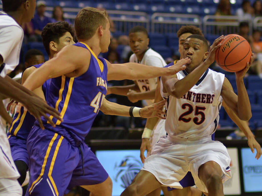 Cy Springs senior guard Freddie Ricks (25) works the ball against Jersey Village senior Jacob Clarkson, left,  during their District 17-6A matchup at the Berry Center in Cypress on Jan. 13, 2017. (Photo by Jerry Baker/Freelance) Photo: Jerry Baker, Freelance / Freelance