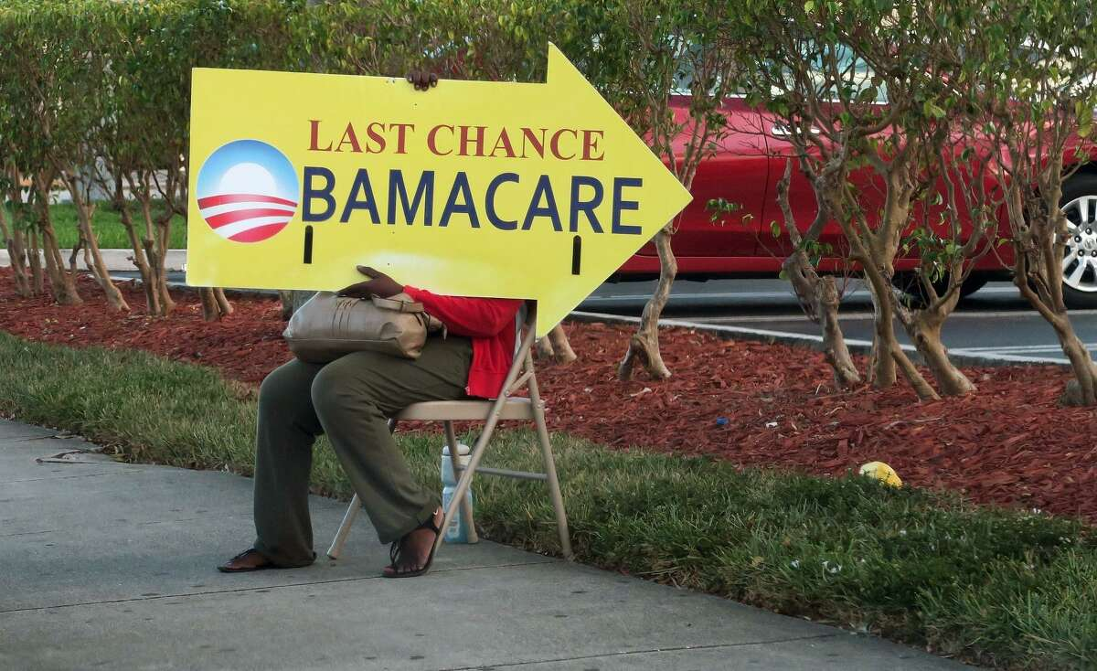 (FILES) This file photo taken on November 27, 2016 shows a woman holding an Obama Care sign in front of a medical center in Miami. The Republican-led US Senate held a procedural vote early January 12, 2017 which set in motion the eventual rollback of The Affordable Care Act, President Barack Obama's signature healthcare reform bill. Votes were held on a fiscal-year budget reconciliation measure between the House and Senate, the legislative vehicle for repealing Obamacare. The measure passed by a vote of 51 to 48. / AFP PHOTO / RHONA WISERHONA WISE/AFP/Getty Images