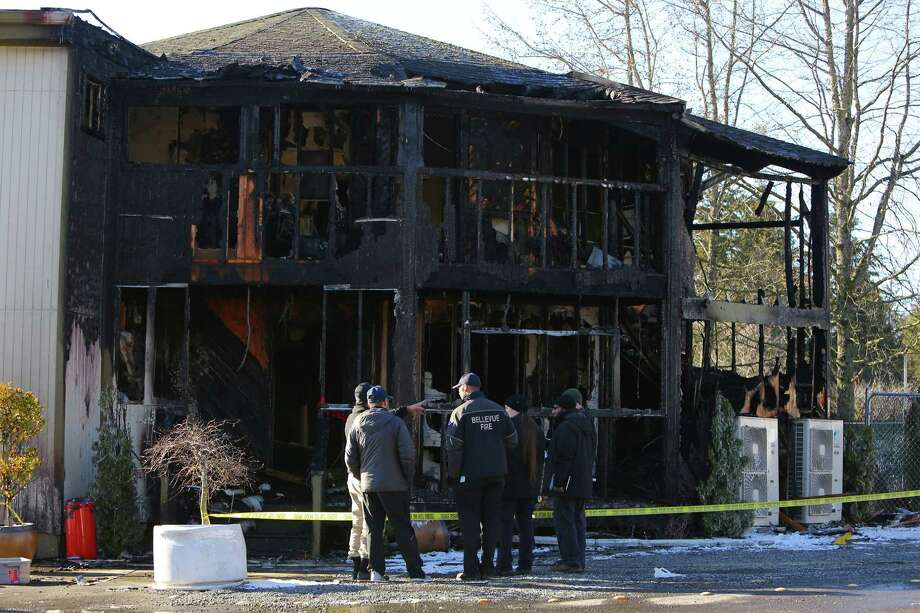 Members of the Bellevue Fire Department, Bellevue Police Department and federal Bureau of Alcohol, Tobacco, Firearms and Explosives (ATF) investigate the scene of an alleged arson fire at the Islamic Center of the Eastside in Bellevue on Saturday morning, Jan. 14, 2017.  The fire began early Saturday morning. One suspect was reportedly in custody. The backside of the building was destroyed. Photo: GENNA MARTIN, SEATTLEPI.COM / SEATTLEPI.COM