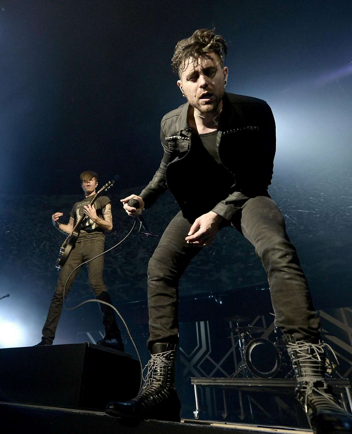 Musicians Jade Puget (L) and Davey Havok of AFI perform onstage during The 24th Annual KROQ Almost Acoustic Christmas at The Shrine Auditorium on December 7, 2013 in Los Angeles, California. (Photo by Kevin Winter/Getty Images for Radio.com)