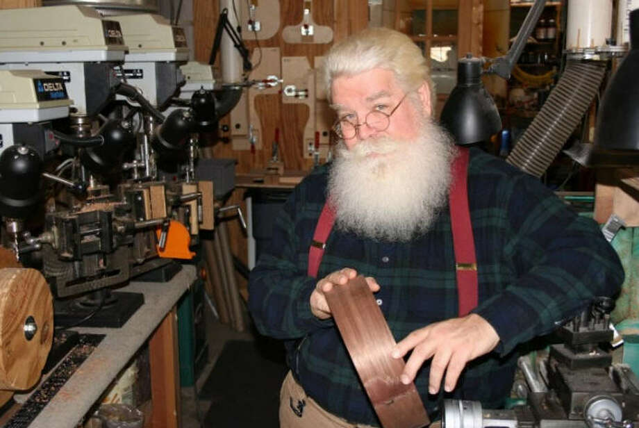 There probably aren't many Kung Fu-practicing, banjo making Santas out there. Chuck Lee is one.The beard, hair and glasses are real. North Texas resident Chuck Lee does indeed play Santa during the holidays. But, he's got a few things to keep him busy in the offseason, like banjo making. Photo: Chuck Lee Banjos