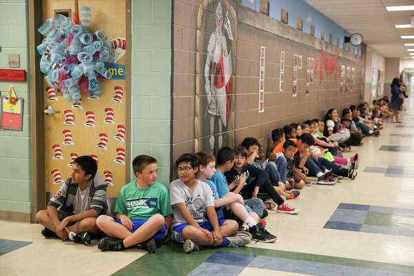 Fifth grader Ryan Stromberg, 10, waits with his classmates  after lunch Wednesday April 6, 2016 at  Judge Andy Mireles Elementary School, which is one of the most crowded schools in Bexar County.