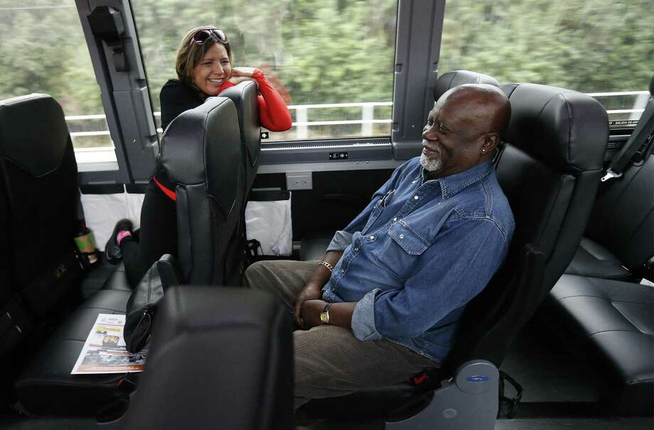 Freedom Rider Fred Anderson (right) shares a laugh with Esther Delgadillo as a gathering of Freedom Riders and supporters ride on a Greyhound bus through Northeast and East Bexar County to mark the historic 1961 civil rights movement on Saturday, Jan. 14, 2017. San Antonio resident Barbara Bowie  who lived in Jackson, Mississippi as a teenager and had first-hand account of segregation and the fight for civil rights was the organizer for Saturday's event. Freedom Riders Fred Anderson, MacArthur Cotton, Kredelle Petway and San Antonio resident Patricia Dilworth joined supporters on a Greyhound bus as it made stops along the way to a parade in their honor. Bus riders had the opportunity to listen to the Freedom Riders tell their stories along the ride and a civil rights hymn or two were also sung during the trip. The bus route started in Selma, Texas and finished by taking part in a parade which ended in Friendship Park in Kirby, Texas. (Kin Man Hui/San Antonio Express-News) Photo: Kin Man Hui, Staff / San Antonio Express-News / ©2017 San Antonio Express-News