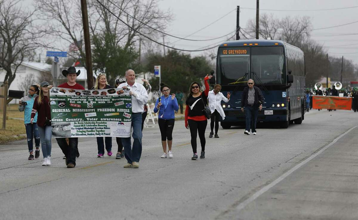 A gathering of Freedom Riders and supporters take part in a parade after a ride on a Greyhound bus through Northeast and East Bexar County to mark the historic 1961 civil rights movement on Saturday, Jan. 14, 2017. San Antonio resident Barbara Bowie who lived in Jackson, Mississippi as a teenager and had first-hand account of segregation and the fight for civil rights, was the organizer for Saturday's event. Freedom Riders Fred Anderson, MacArthur Cotton, Kredelle Petway and San Antonio resident Patricia Dilworth joined supporters on a Greyhound bus as it made stops along the way to a parade in their honor. Bus riders had the opportunity to listen to the Freedom Riders tell their stories along the ride and a civil rights hymn or two were also sung during the trip. The bus route started in Selma, Texas and finished by taking part in a parade which ended in Friendship Park in Kirby, Texas. (Kin Man Hui/San Antonio Express-News)
