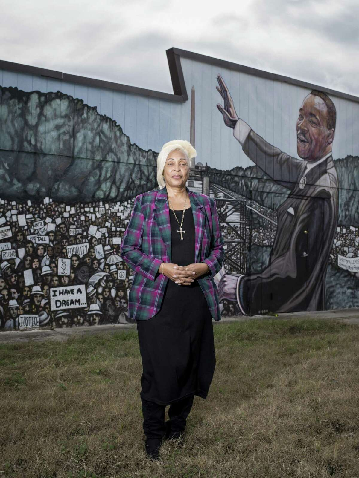 Rosa L. Wilson, pastor of the Greater Faith Institutional Church poses for a portrait in front of the church's mural of Martin Luther King Jr. on Saturday, January 14, 2017 in San Antonio, Texas.