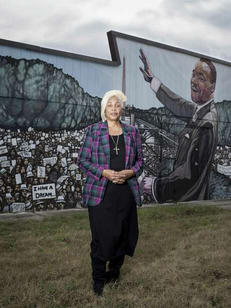 Rosa L. Wilson, pastor of the Greater Faith Institutional Church poses for a portrait in front of the church's mural of Martin Luther King Jr. on Saturday, January 14, 2017 in San Antonio, Texas. Photo: Matthew Busch, For The San Antonio Express-News / For The San Antonio Express-News / © Matthew Busch