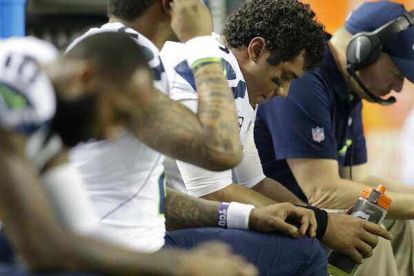 Seattle Seahawks quarterback Russell Wilson (3) sits with players on the bench during the second half of an NFL football divisional football game against the Atlanta Falcons, Saturday, Jan. 14, 2017, in Atlanta. (AP Photo/David Goldman)