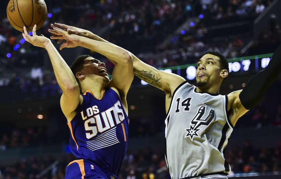 Phoenix Suns Devin Booker (L) vies for the ball with San Antonio Spurs´ Dany Green (R), during an NBA Global Games match at the Mexico City Arena, on January 14, 2017, in Mexico City. / AFP PHOTO / RONALDO SCHEMIDTRONALDO SCHEMIDT/AFP/Getty Images Photo: RONALDO SCHEMIDT/AFP/Getty Images