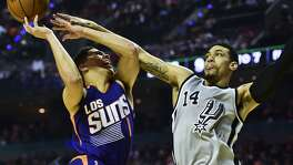 Phoenix Suns Devin Booker (L) vies for the ball with San Antonio Spurs´ Dany Green (R), during an NBA Global Games match at the Mexico City Arena, on January 14, 2017, in Mexico City. / AFP PHOTO / RONALDO SCHEMIDTRONALDO SCHEMIDT/AFP/Getty Images
