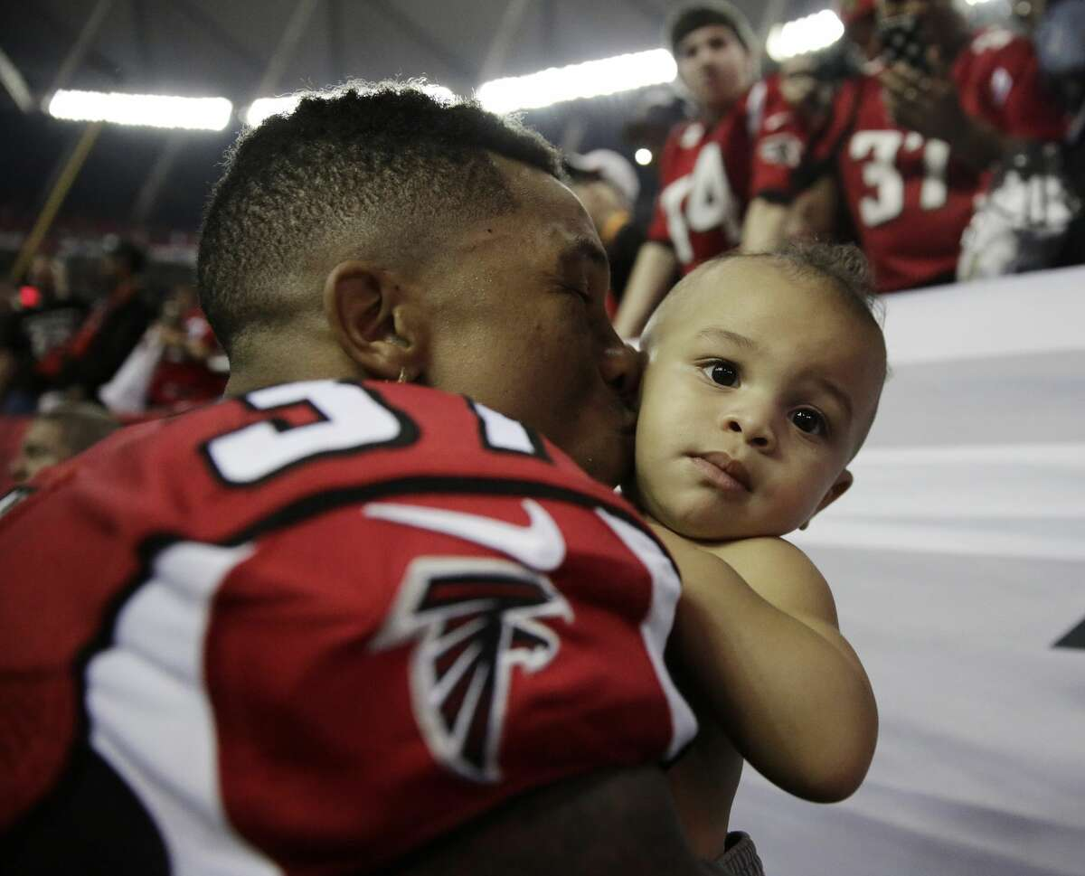 Atlanta free safety Ricardo Allen kisses his 10-month-old son, Luca, after the Falcons' 36-20 win.