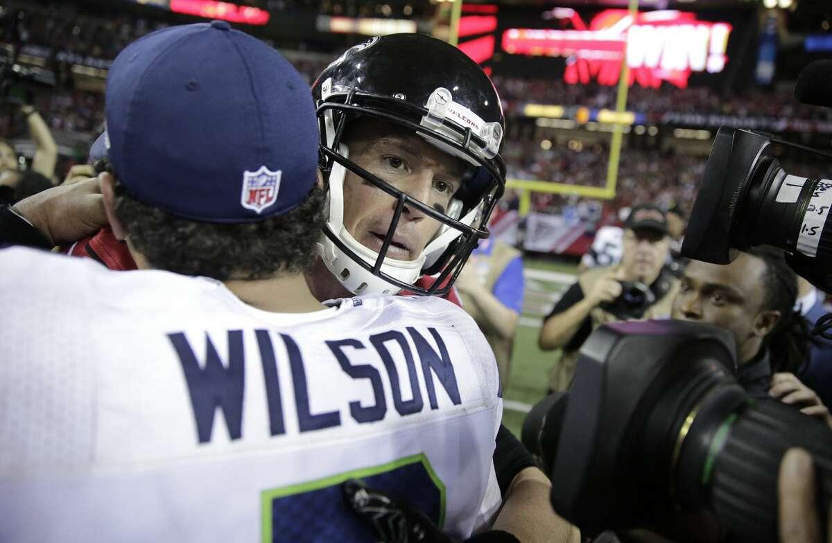 Atlanta quarterback Matt Ryan, right, embraces Seahawks quarterback Russell Wilson after the game. The Falcons won 36-20.