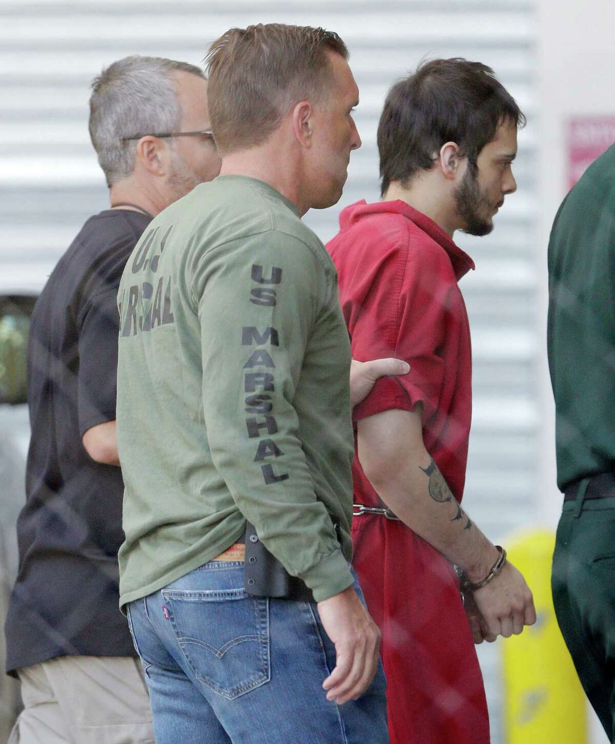 FILE- In this Jan. 9, 2017 file photo, Esteban Santiago, right, accused of fatally shooting several people and wounding multiple others at a crowded Florida airport baggage claim, is returned to Broward County's main jail after his first court appearance in Fort Lauderdale, Fla. Authorities say such walk-ins are a daily occurrence around the country. Assessing whether the people are reporting a credible threat or whether they need medical help is extremely difficult and drains already-stretched law enforcement resources. (AP Photo/Alan Diaz, File)