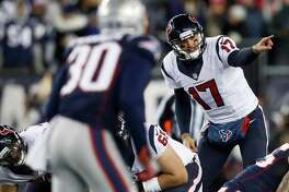Houston Texans quarterback Brock Osweiler (17) motions to the offense during the first quarter of an NFL divisional playoff game at Gillette Stadium, Saturday, January 14, 2017.