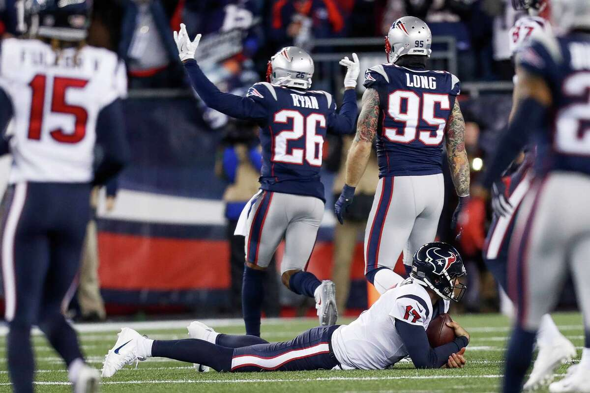 Houston Texans quarterback Brock Osweiler (17) reacts after bing sacked during the first quarter of an NFL divisional playoff game at Gillette Stadium, Saturday, January 14, 2017.