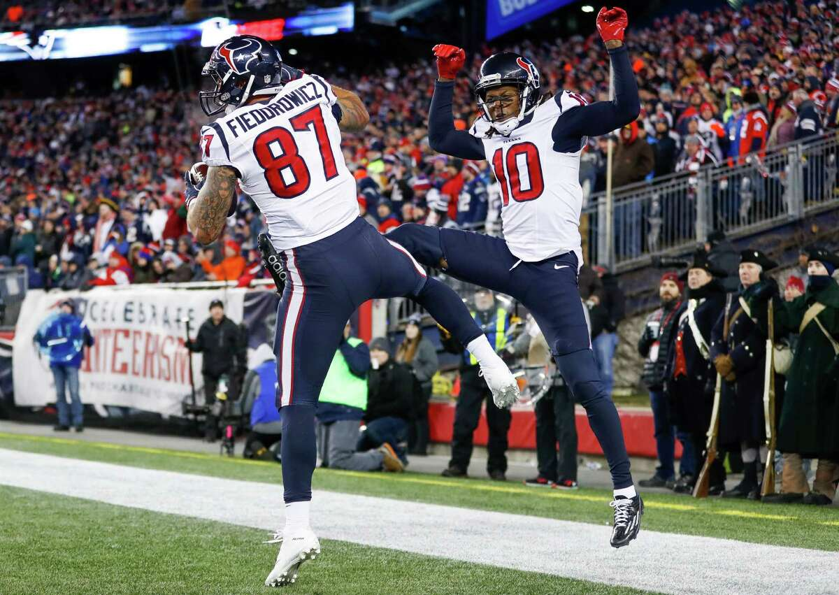 McCLAIN'S REPORT CARD FOR TEXANS-PATRIOTS PLAYOFF GAME Wide receiver/tight end C.J. Fiedorowicz caught a touchdown pass for the team's only touchdown. DeAndre Hopkins had six catches for 65 yards. Will Fuller dropped what should have been a long touchdown pass.  Grade: C