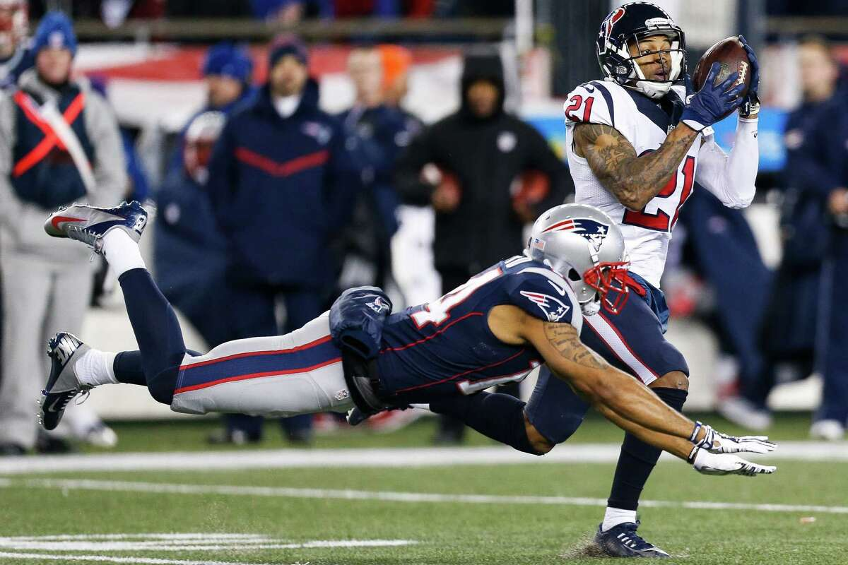 Houston Texans cornerback A.J. Bouye (21) catches an interception past New England Patriots wide receiver Michael Floyd (14) during the second quarter of an NFL divisional playoff game at Gillette Stadium, Saturday, January 14, 2017.