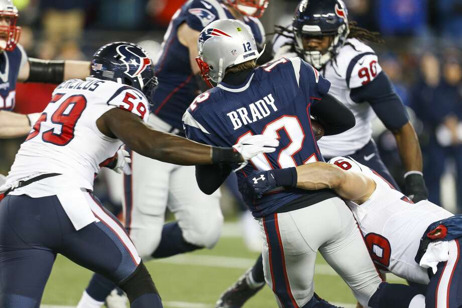 Getting pressure on Patriots QB Tom Brady will be imperative for Whitney Mercilus (59) and the rest of the Texans' defense Sunday. Photo: Brett Coomer/Houston Chronicle