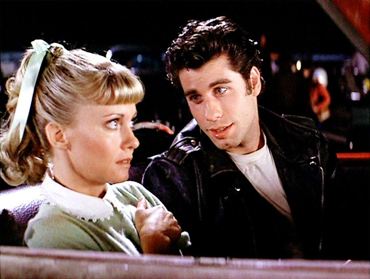 John Travolta is the greaser Danny, and Olivia Newton John is the good girl Sandy in