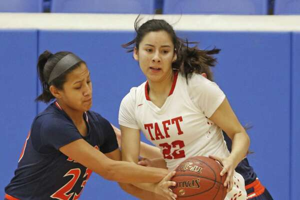BrandeisÕs Ariana Villa tries to tie up TaftÕs Brianna Cuellar in the District 28-6A girls basketball game on Saturday, January 14, 2017 at Northside ISD Gym.